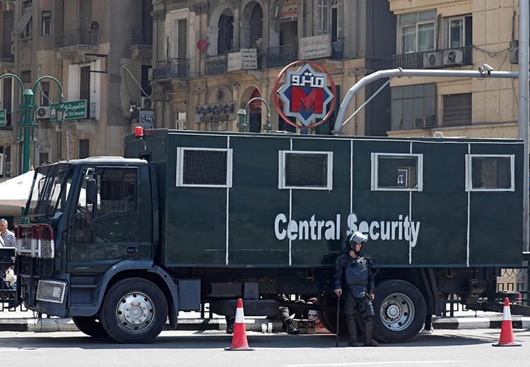 Egyptian security forces are seen in Cairo on May 13, 2018. Security forces recently arrested the son of al-Mashhad editor Magdi Shandi. (Reuters/Amr Abdallah Dalsh)