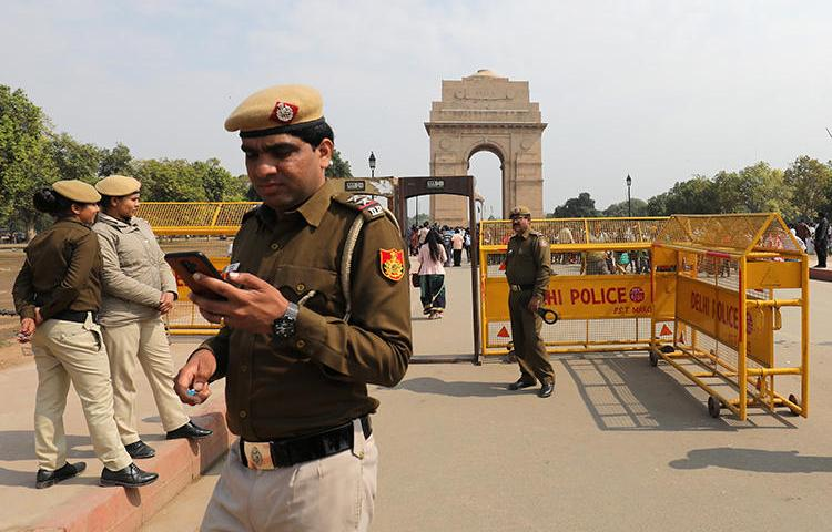 Police are seen in New Delhi, India, on February 27, 2019. Kashmiri journalist Gowhar Geelani was recently barred from leaving the country at a New Delhi airport. (Reuters/Anushree Fadnavis)