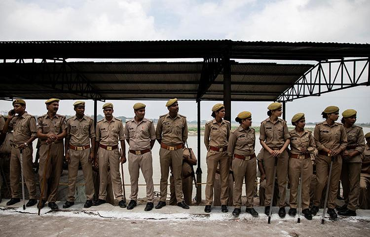 Police are seen in Unnao, Uttar Pradesh, India, on July 31, 2019. Police in Uttar Pradesh recently arrested, investigated, and filed complaints against several journalists. (Reuters/Danish Siddiqui)