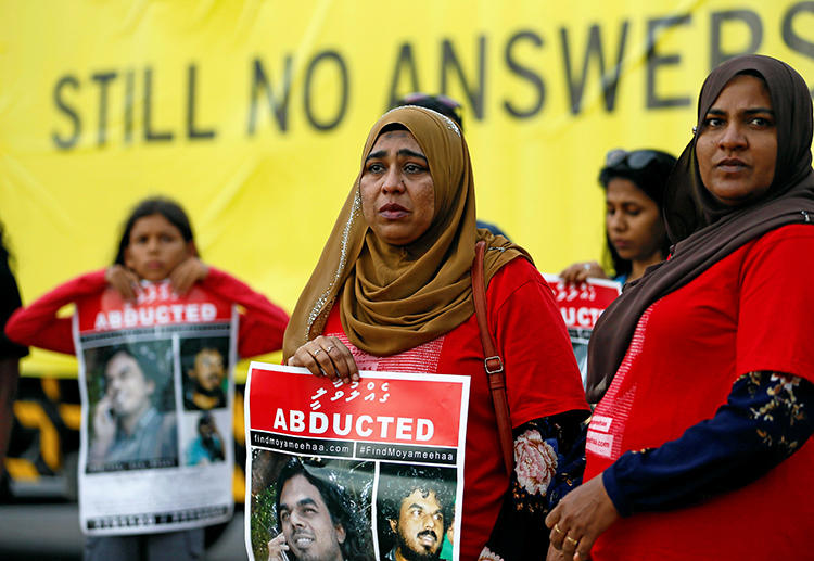 Family members of Maldivian journalist Ahmed Rilwan Abdulla are seen in Colombo, Sri Lanka, on August 28, 2018. A presidential commission in the Maldives recently announced that the journalist was killed in 2014. (Reuters/Dinuka Liyanawatte)