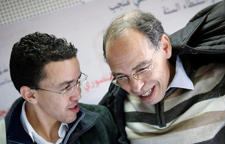 Maati Monjib, right, chats with Moroccan journalist Hicham Mansouri in Rabat, Morocco, January 17, 2016. Amnesty International reported this month that Monjib has been sent malicious messages in an attempt to install spyware on his phone. (AP Photo/Abdeljalil Bounhar)