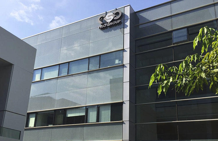 The logo of the Israeli NSO Group company is shown on a building where they had offices in Herzliya, Israel. WhatsApp has accused NSO Group of selling technology to help governments spy on WhatsApp users, including journalists. (AP/Daniella Cheslow)