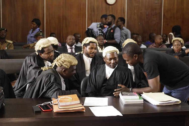 CrossRiverWatch journalist Agba Jalingo (right) is seen in a federal high court in Calabar, Nigeria. Jalingo is due in court tomorrow on amended charges of cybercrime and terrorism. (Oto-Obongo Clement/CrossRiverWatch)