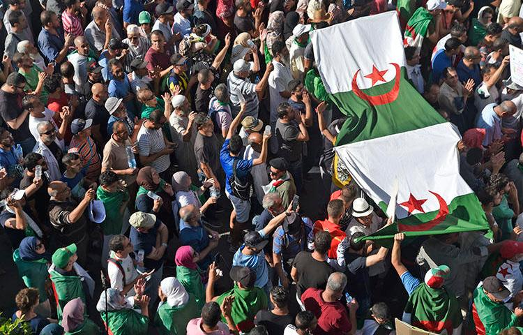 Protesters chant slogans during anti-government demonstrations in Algiers, on October 18, 2019. Police have arrested at least five journalists in recent weeks. (AFP/Ryad Kramdi)