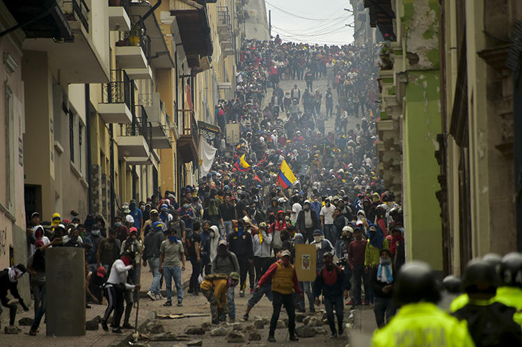 Demonstrators clash with riot police in Quito, as thousands march against Ecuadoran President Lenin Moreno's decision to slash fuel subsidies, on October 9, 2019. Both the authorities and protesters have targeted the press amid the protests. (AFP/Rodrigo Buendia)