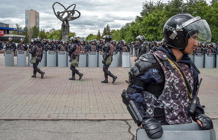 Police officers are seen in Nur-Sultan, Kazakhstan, on June 10, 2019. Kazakh journalist Amangeldy Batyrbekov was recently jailed on criminal libel charges. (AFP/Vyacheslav Oseledko)