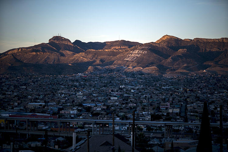 Ciudad Juarez in Mexico is pictured nestled against El Paso, Texas. A member of a National Geographic crew was shot in the leg when gunmen attacked a residence where the group was interviewing an alleged gang member. (Paul Ratje/AFP)
