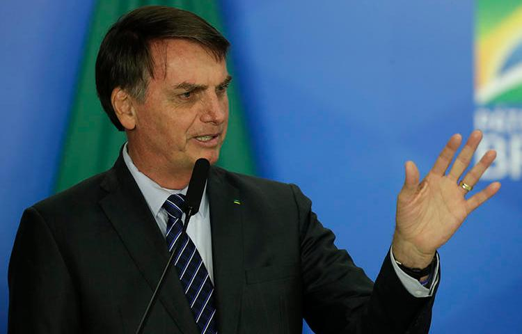 Brazilian President Jair Bolsonaro is seen in Brasilia on October 8, 2019. Bolsonaro recently insulted and threatened the Globo media company. (AP/Eraldo Peres)
