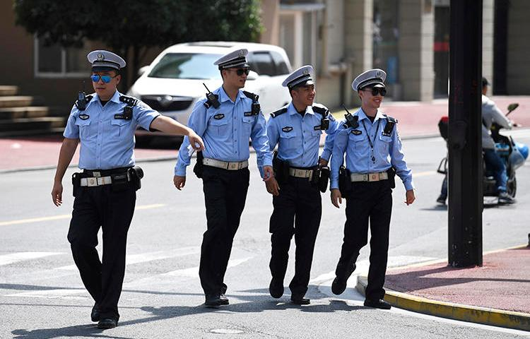 Police officers are seen in Shanghai on July 30, 2019. Police in Guangzhou recently arrested journalist Sophia Huang Xueqin. (AP/Greg Baker)