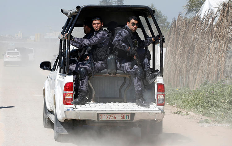 Members of Palestinian Hamas security forces are seen in the Gaza Strip on March 13, 2018. Security forces recently arrested journalist Hani al-Agha. (Reuters/Mohammed Salem)