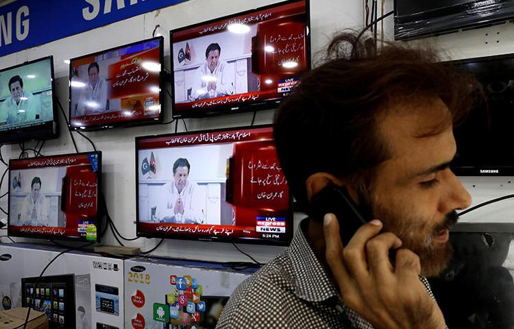 News broadcasts are seen on televisions in Karachi, Pakistan, on July 26, 2018. The country's media regulator recently issued mixed messages regarding news anchors' abilities to express their opinions. (Reuters/Akhtar Soomro)