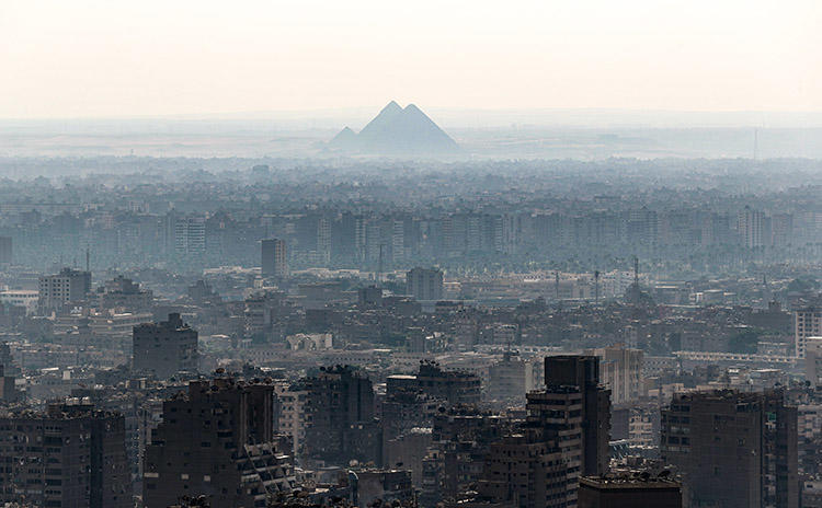 A view of Giza Pyramids, taken from Cairo Tower on October 23, 2019. Security officers raided the Cairo offices of Mada Masr on November 24 and detained three staff. (AFP/Mohamed el-Shahed)