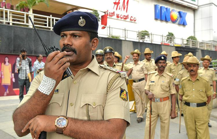 Karnataka state police are seen in Bangalore on June 7, 2018. Police recently arrested publisher Doddipalya Narasimha Murthy in a 25-year-old case. (AFP/Manjunath Kiran)