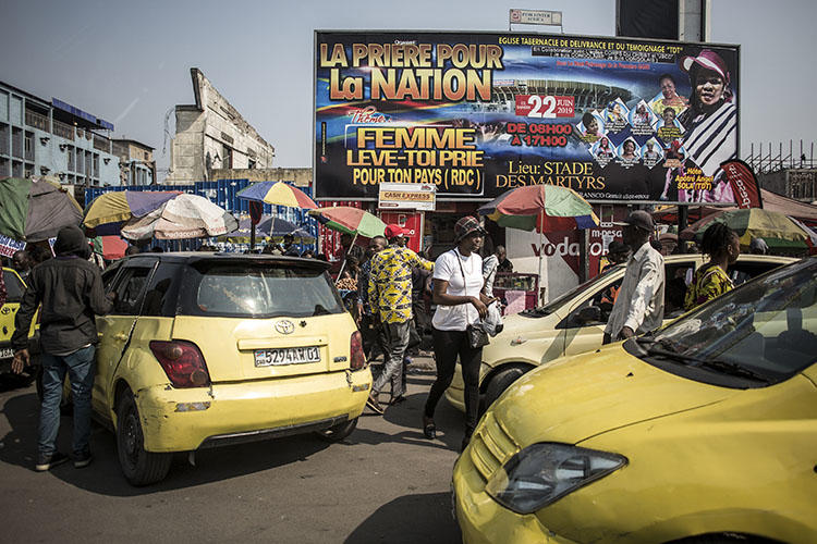 Taxis in Kinshasa in June 2019. Police in the Democratic Republic of Congo capital detained a journalist for five days over a criminal defamation complaint. (AFP/John Wessels)