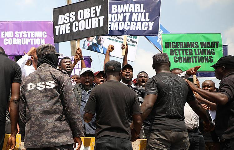 Demonstrators are seen outside the Department of State Services headquarters in Abuja, Nigeria, on November 12, 2019. Police fired on and attacked journalists covering that demonstration. (AFP/Kola Sulaimon)