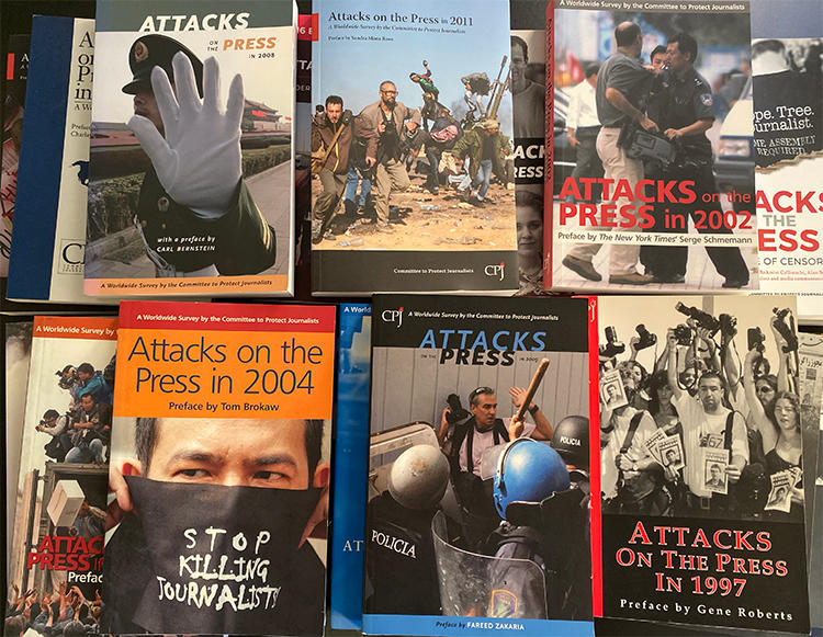 Covers of CPJ's 'Attacks on the Press' books. Starting in 1987, the annual publication acted as a database of press freedom violations. (CPJ/Mustafa Hameed)