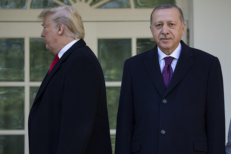 President Donald Trump walks toward the Oval Office after posing for photographers with Turkey's President Recep Tayyip Erdoğan on November 13. Turkey detained at least six journalists in the same week as Erdoğan's visit to the U.S. (AP/Evan Vucci)