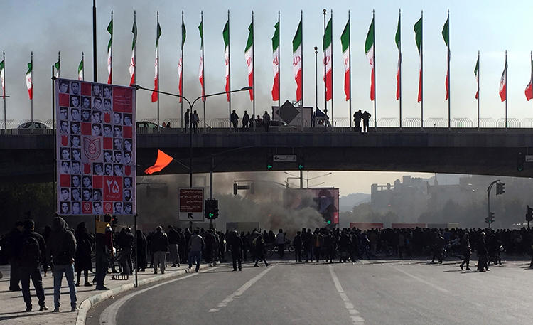 Smoke rises during a protest in Isfahan, Iran, on November 16, 2019. Iranian authorities have cut internet access nationwide amid the protests. (AP Photo)