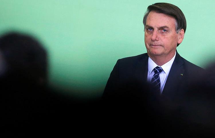 "Brazilian President Jair Bolsonaro is seen in Brasilia on November 12, 2019. On November 8, Bolsonaro enacted a ""slanderous denunciation"" law under Brazil's electoral code. (Reuters/Adriano Machado)"