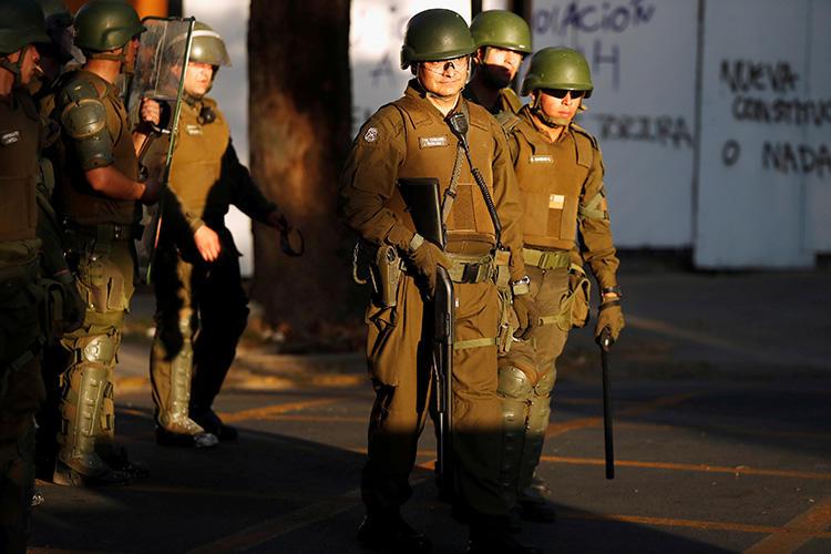 Police are seen in Santiago, Chile, on November 6, 2019. Police are investigating the recent killing of journalist Albertina Martínez Burgos in Santiago. (Reuters/Jorge Silva)
