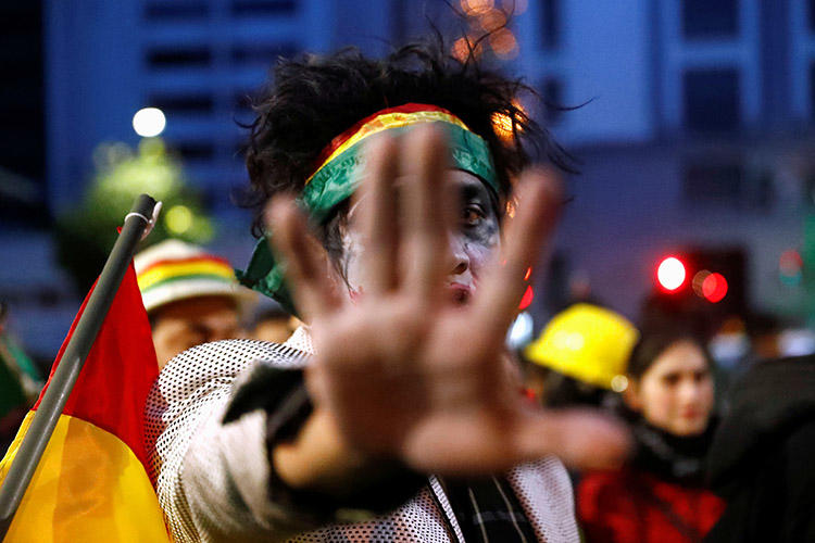 A demonstrator gestures during a protest in La Paz on November 9, 2019. Several news outlets were attacked and threatened over the weekend, following unrest that led to the resignation of President Evo Morales. (Reuters/Kai Pfaffenbach)