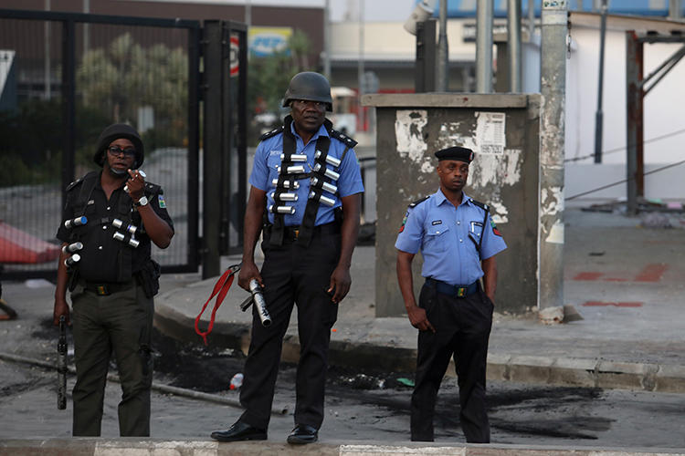Police officers are seen near Lagos, Nigeria, on September 3, 2019. Journalists in Kogi and Bayelsa states reported being harassed and threatened during recent elections. (Reuters/Temilade Adelaja)