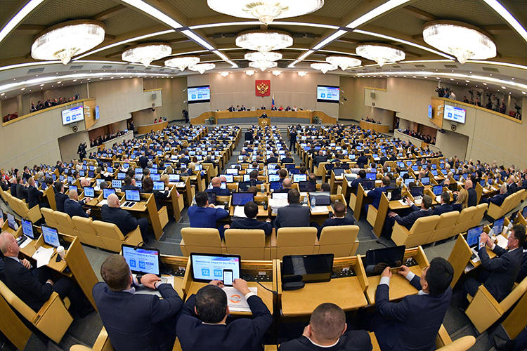 """Russia's lower house of parliament, the State Duma, is seen in Moscow on April 17, 2019. The State Duma recently passed legislation that would add individual journalists and bloggers to the country's list of """"foreign agents."""" (Reuters/Sputnik/Alexander Astafyev)"""