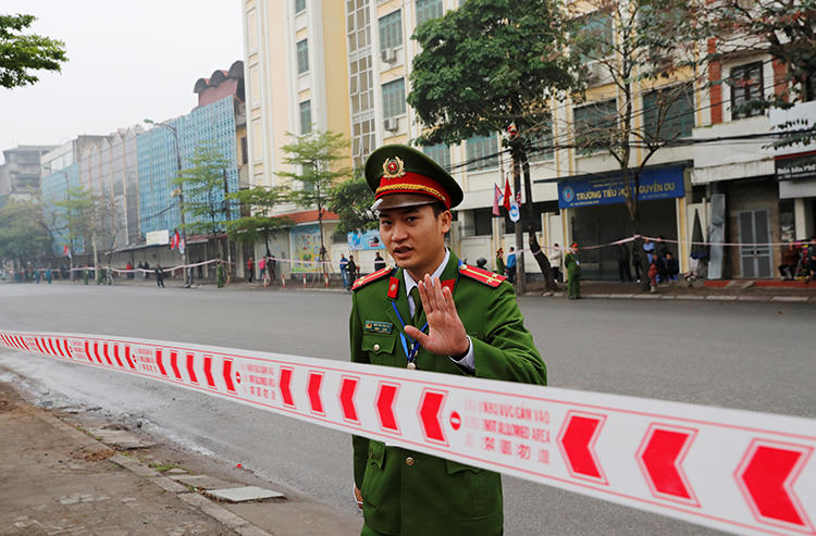A police officer is seen in Hanoi, Vietnam, on February 26, 2019. Police recently arrested journalist Pham Chi Dung on anti-state charges. (Reuters/Kim Kyung-Hoon)