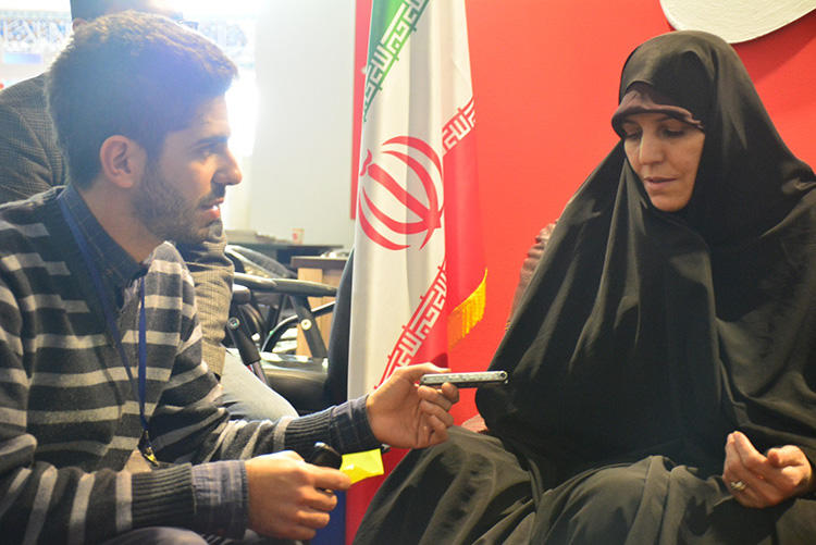 Pouyan Khoshhal interviews Shahindokht Molaverdi, Iran's then vice-president for women and family affairs, in Tehran in 2015. When Khoshhal was released on bail, guards told him to quit journalism. (Pouyan Khoshhal)