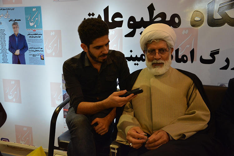 Pouyan Khoshhal pictured during an interview with Mohsen Rohami, an Iranian lawyer, cleric and reformist politician, in 2016. Khoshhal says he had to censor himself constantly while reporting in Iran. (Pouyan Khoshhal)