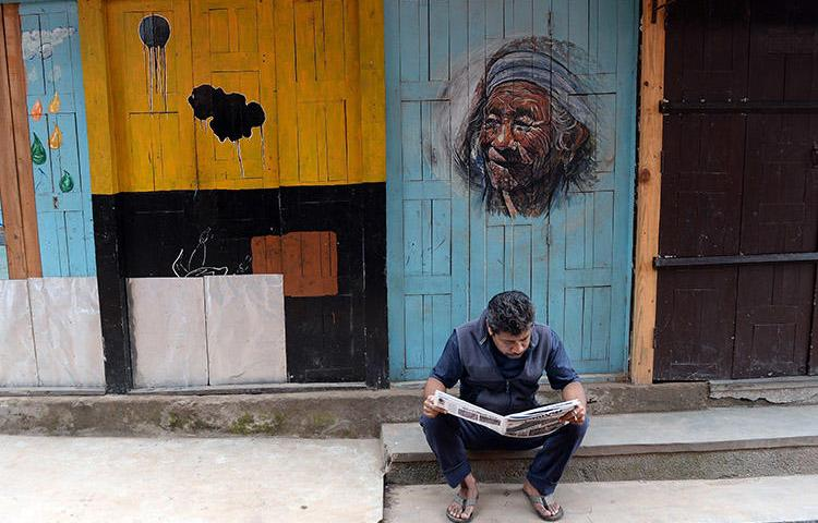 A man reads a newspaper in Bhaktapur, near Kathmandu, in May 2015. Journalists in Nepal say proposed regulations and pressure from authorities are damaging press freedom. (AFP/Prakash Singh)