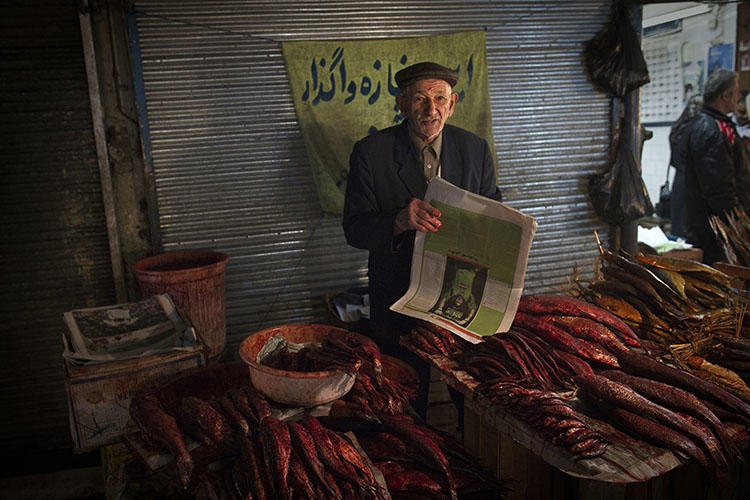 A fishmonger pictured at a bazaar in the Iranian city of Rasht, in March 2011. In 2018, Turkey extradited a journalist from Rasht whom authorities later sentenced to 10 years in prison for his work. (AFP/Behrouz Mehri)