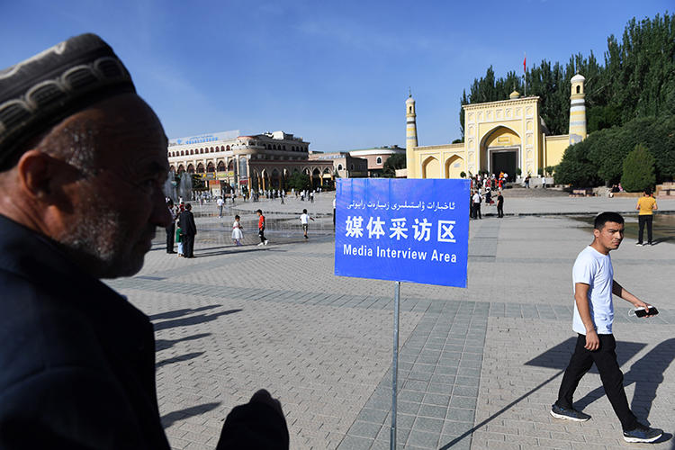 "A June 5, 2019, photo shows a ""media interview area"" for reporters set up near the Idkah mosque on the morning of Eid al-Fitr, when Muslims around the world celebrate the end of Ramadan, in Kashgar, in China's northwestern Xinjiang region. China was the world's leading jailer of journalists in 2019, with at least 48 in prison. (AFP/Greg Baker)"