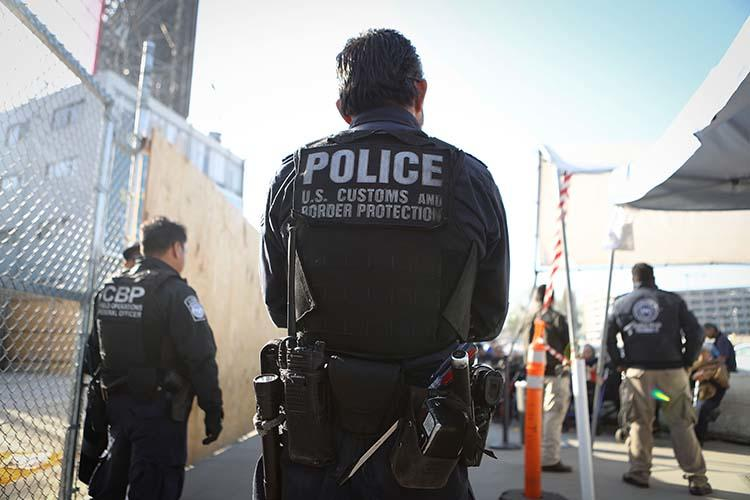 A U.S. Customs and Border Protection officer waits for pedestrians entering the United States on April 9, 2018 at the San Ysidro port of entry in California. Warrantless searches of devices belonging to journalists and other travelers at the border violate the U.S. constitution, a Massachusetts district court judge ruled in November. (Getty Images/AFP/Mario Tama)