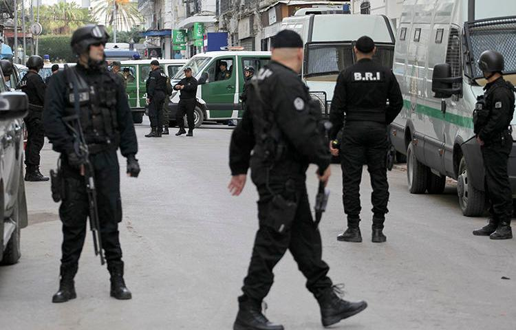 Algerian security forces are seen in Algiers on December 4, 2019. Authorities recently sentenced cartoonist Benabdelhamid Amine to three months in prison. (AP/Toufik Doudou)