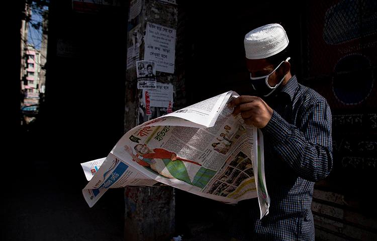 A man reads a newspaper in Dhaka, Bangladesh, on December 31, 2018. Police recently arrested and detained newspaper editor Abdul Asad. (AP/Anupam Nath)