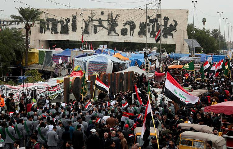 Demonstrators are seen in Tahrir Square in Baghdad, Iraq, on December 6, 2019. One journalist was killed and another went missing after covering protests on December 6. (AP/Hadi Mizban)