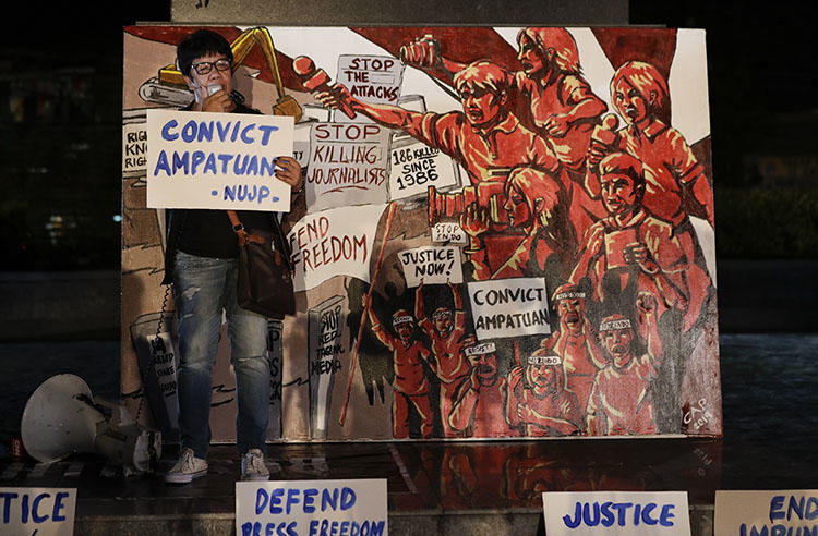 A relative of one of the Maguindanao massacre victims addresses the crowd during a rally to call for justice in Quezon city, on December 18, 2019. A Philippines court today issued its verdict on the 2009 attack, in which 58 people, including 32 journalists and media workers, were killed. (AP/Aaron Favila)