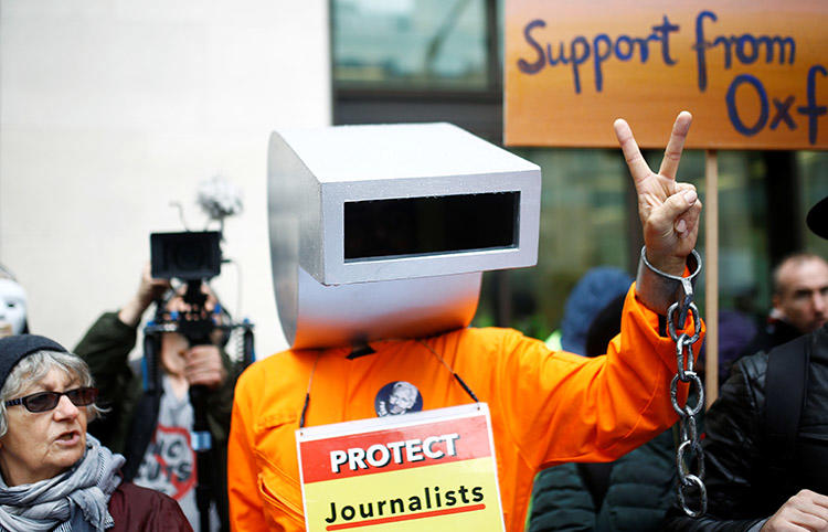 A demonstrator dressed as a whistle protests outside of a London court holding a hearing on the U.S. extradition case of WikiLeaks founder Julian Assange in October 2019. (Reuters/Henry Nicholls)