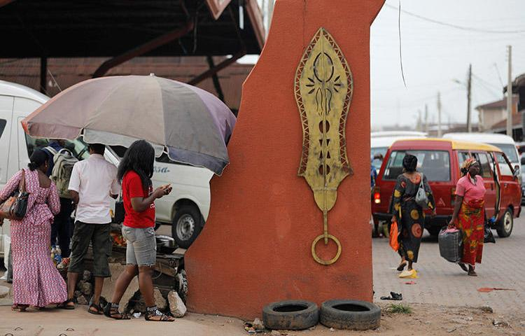 Brass work hangs at the entrance to Igun Street in the Edo state capital of Benin City, in June 2018. A journalist for Rave Television was attacked while covering a protest in the Nigerian city in November 2019. (Reuters/Akintunde Akinleye)