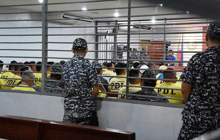 Some of the accused in the 2009 Maguindanao massacre are seen attending the promulgation of the case inside a Taguig City prison, in this December 19, 2019 handout picture. A court today found masterminds Andal Ampatuan Jr., his brother Zaldy Ampatuan, and 26 accomplices guilty of murder for the November 23, 2009 attack that killed 58 people, including 32 journalists and media workers. (Handout via Reuters)