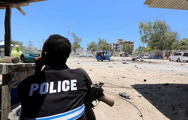 A police officer is seen in Mogadishu, Somalia, on March 23, 2019. Somali authorities recently shut down local broadcaster City FM and briefly detained its staffers. (Reuters/Feisal Omar)