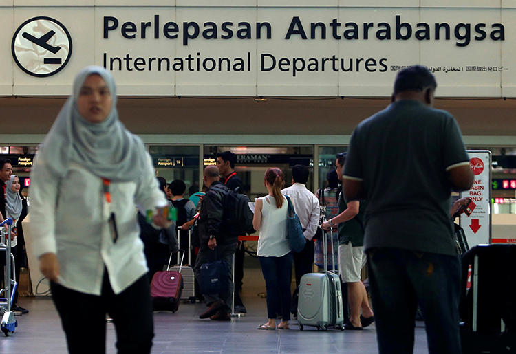 Travelers are seen at Kuala Lumpur International Airport in Malaysia on February 15, 2016. Syrian Kurdish journalist Himbervan Kousa was recently arrested at the airport. (Reuters/Lai Seng Sin)