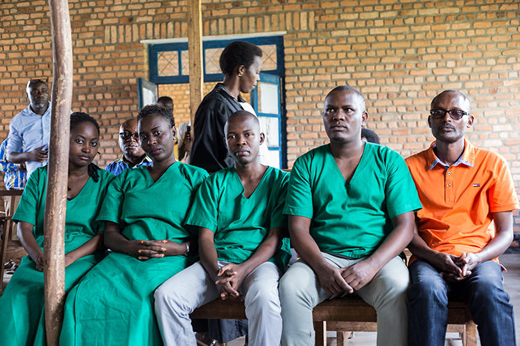 Four Iwacu journalists, (L to R) Agnes Ndirubusa, Christine Kamikazi, Egide Harerimana, Terence Mpozenzi, and the driver Adolphe Masabarakiza, appear at the High Court in Bubanza, western Burundi, on December 30, 2019. The court today convicted the journalists on state security charges. (AFP/Tchandrou Nitanga)