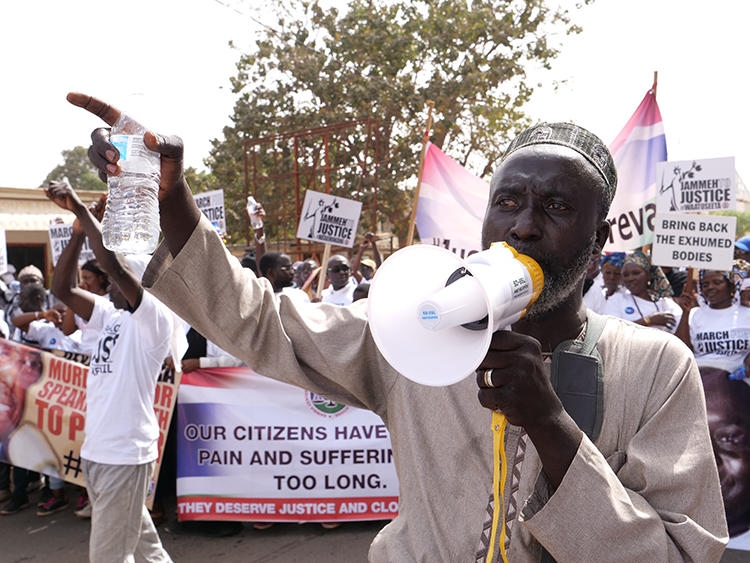 A demonstrator is seen in Banjul, Gambia, on January 25, 2020. Two radio stations were recently shut down and their staffers arrested over their coverage of the protests. (AFP/Romain Chanson)