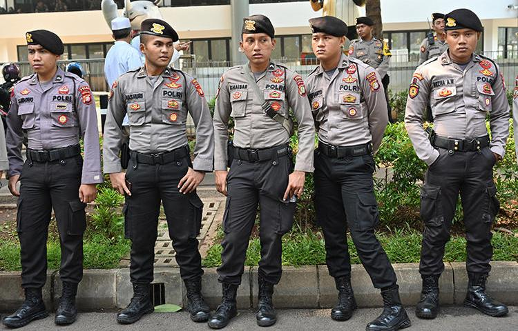 Police officers are seen in Jakarta, Indonesia, on April 7, 2019. Authorities recently arrested and detained U.S. environmental journalist Philip Jacobson. (AFP/Adek Berry)