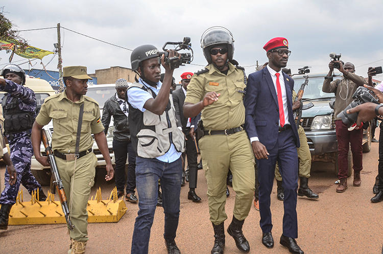 Ugandan politician Robert Kyagulanyi, also known as Bobi Wine, is seen in Kasangati on January 6, 2020. Four journalists were arrested during Wine's visit to Kasangati, and others were questioned by police at another event. (AFP)