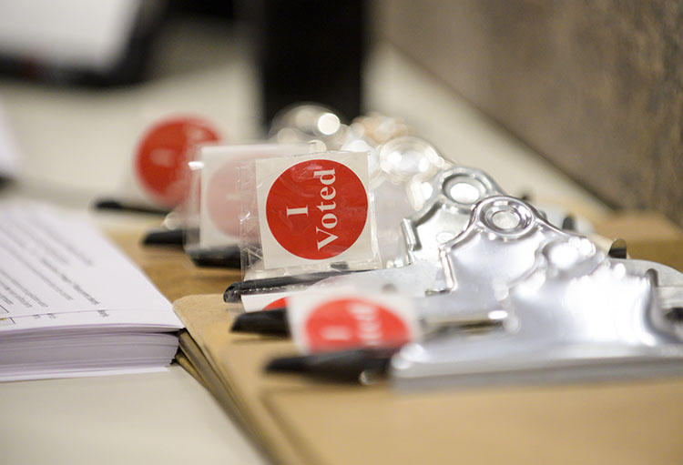 'I Voted' stickers and registration forms pictured on January 17, 2020, the first day of early voting in Minneapolis, Minnesota. CPJ Emergencies has resources and tips for journalists covering the U.S. 2020 election. (Getty/AFP/Stephen Maturen)