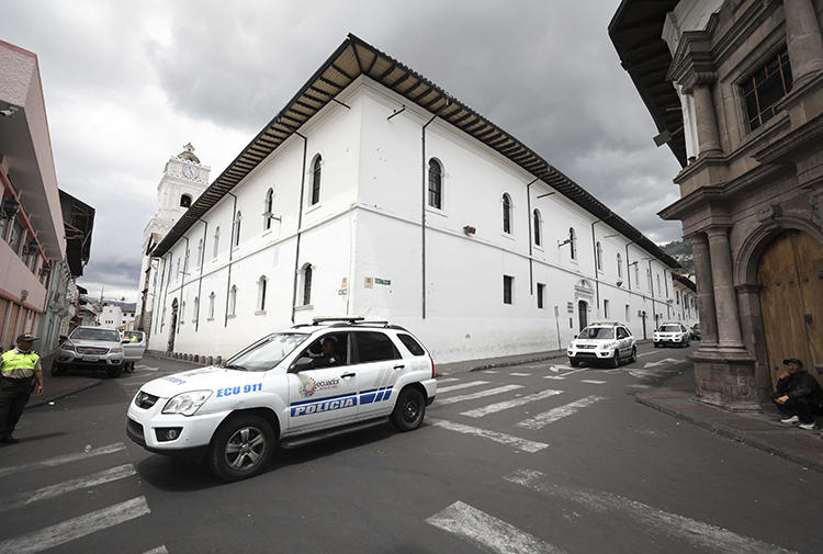Police vehicles are seen in Quito, Ecuador, on October 13, 2019. Ecuador's broadcast regulator recently revoked radio station Pichincha Universal's broadcast license. (AP/Fernando Vergara)