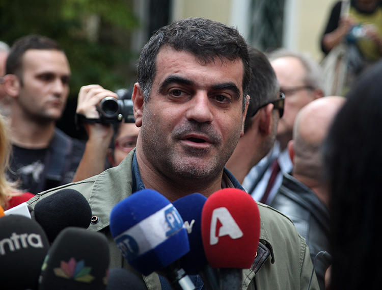 Journalist Kostas Vaxevanis is seen in Athens on October 29, 2012. Vaxevanis was recently convicted in a criminal defamation suit. (AP/Eurokinissi)
